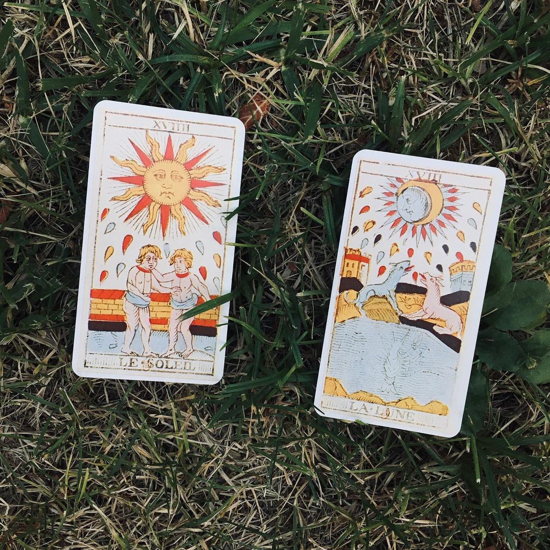 Tarot Cards on the grass, The Sun and the Moon