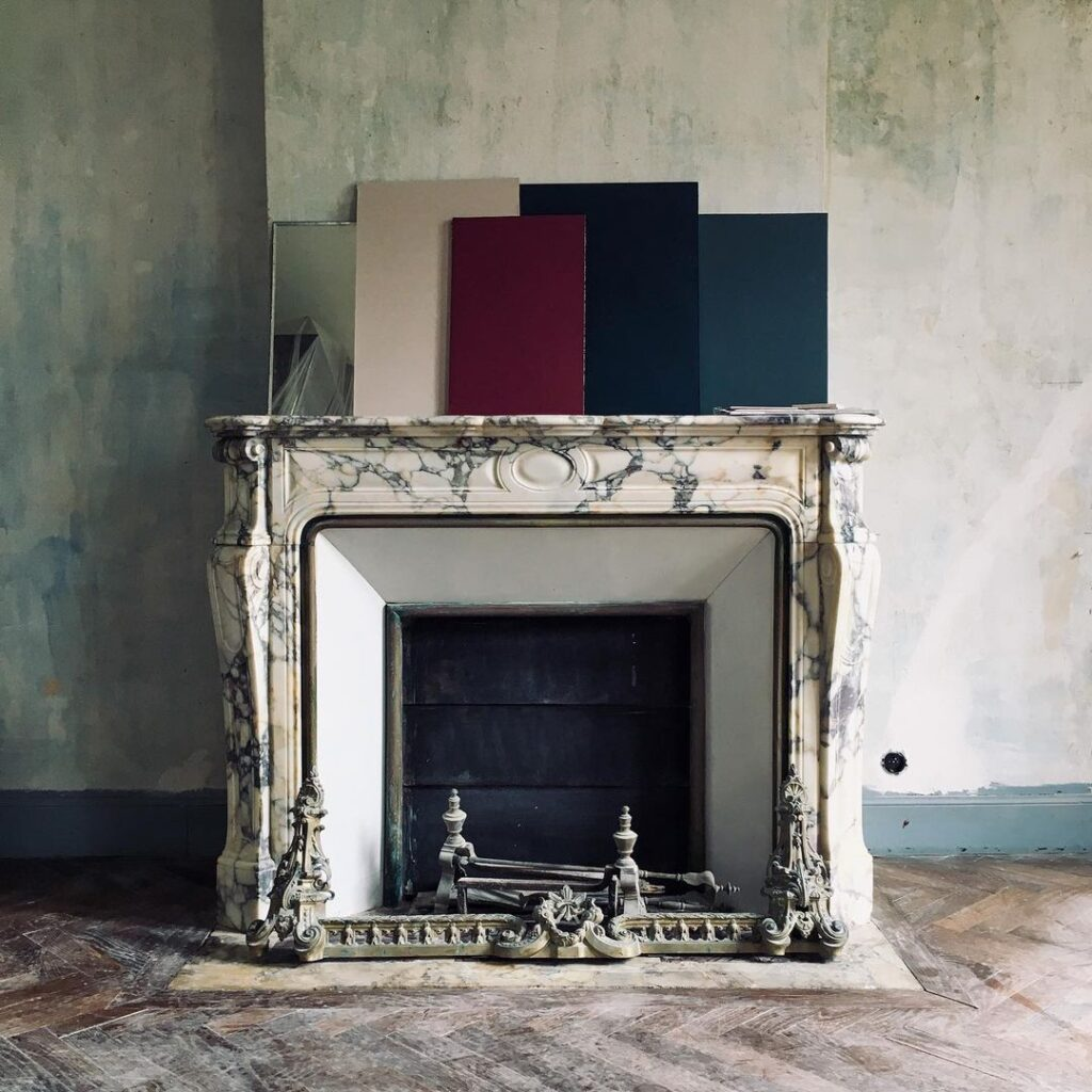 Old marble fireplace with colour tests
